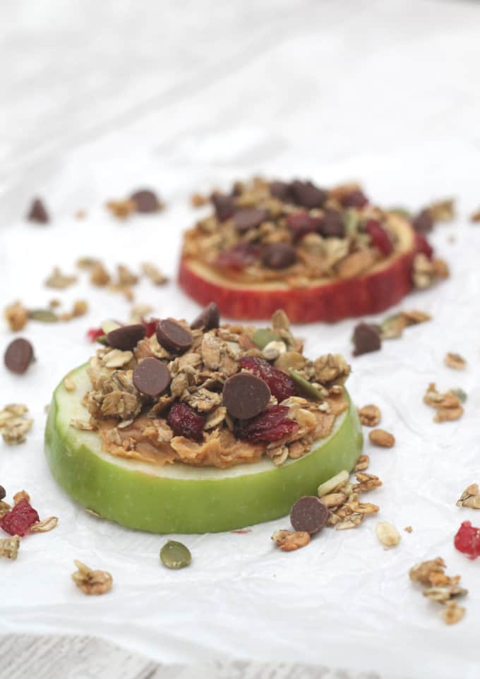 apple slices topped with peanut butter, granola and chocolate chips