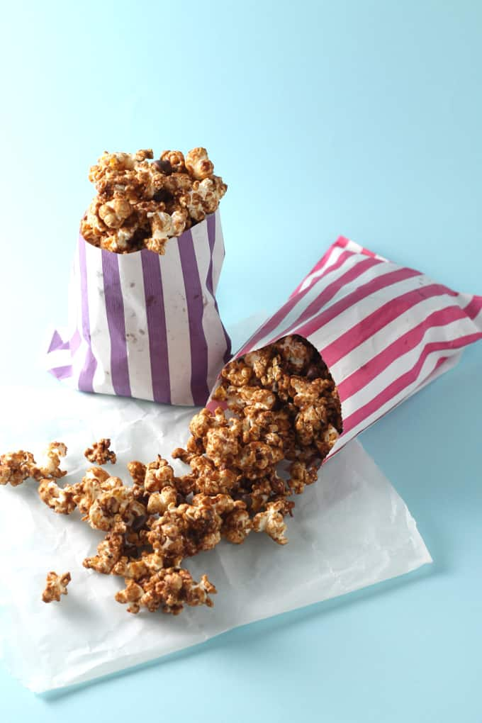 ... popcorn topped with salted caramel sauce and dark chocolate chips