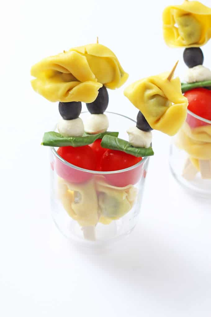A fun way of serving tortellini.; on a stick with tomato, mozarella and basil. Great for kids and picky eaters!