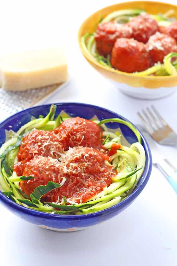 Get your kids to eat more veg by swapping some of their normal pasta for zucchini noodles (or courgette noodles!) | Serve with meatballs for a delicious and nutritious meal!