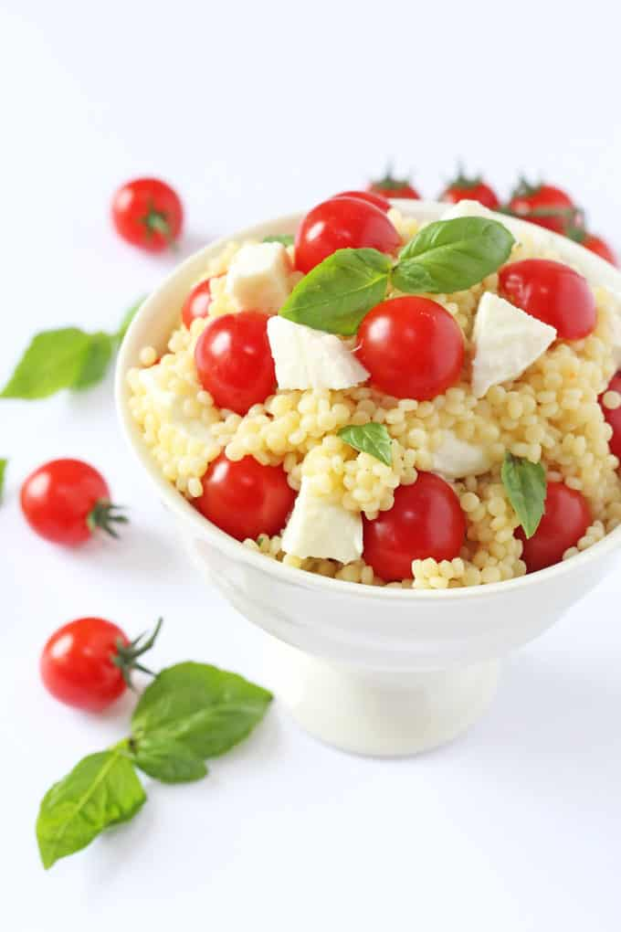 A fresh and colourful summer salad recipe made with giant cous cous, mozarella, cherry tomatoes and basil | My Fussy Eater blog
