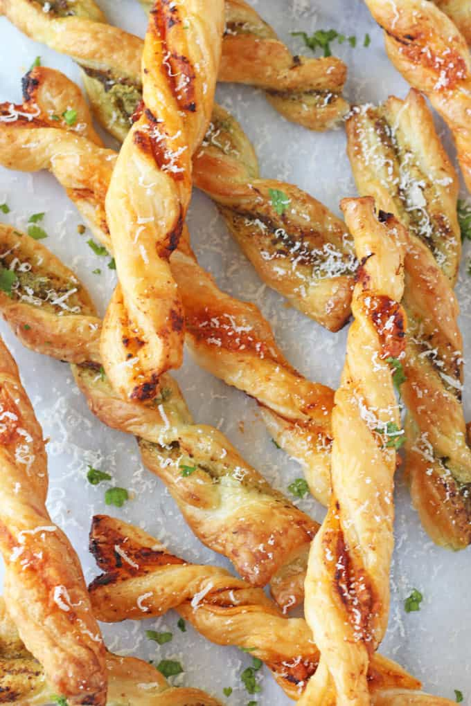 These Pesto Parmesan Pastry Straws make a super easy snack or party appetizer for the festive season!