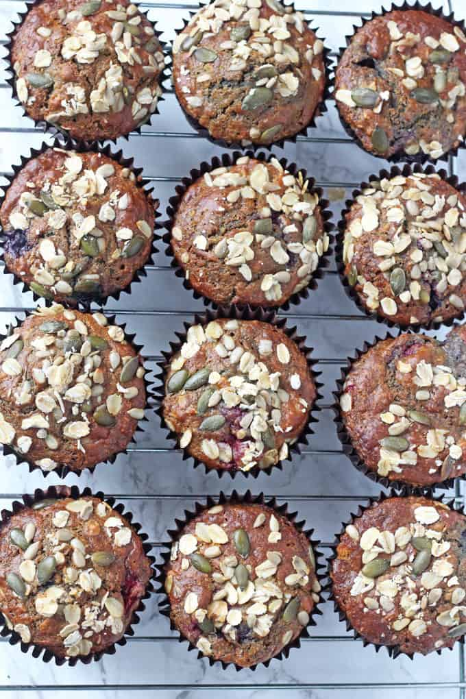 Delicious and filling Berry Breakfast Muffins packed full of healthy ingredients including oats, yogurt, coconut oil, banana and apple sauce.