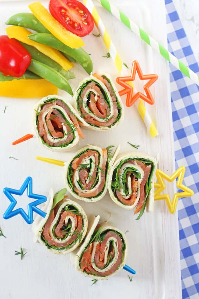 Really easy to make and packed with nutritious ingredients, these Salmon Pinwheels make an excellent lunch for kids either at home or packed into a lunchbox!