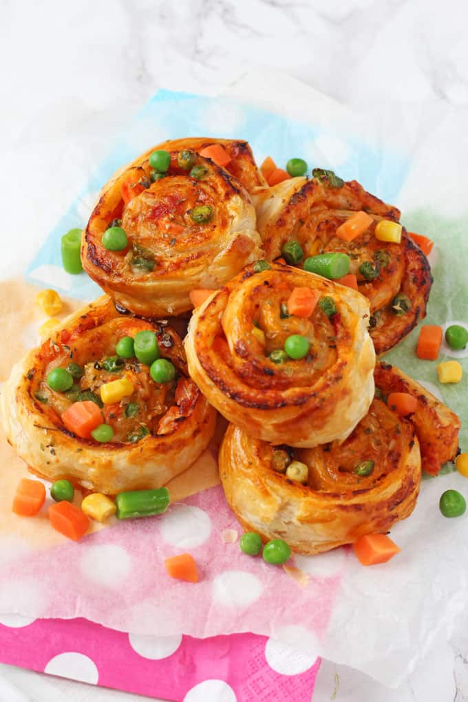 Super easy to make and packed with mixed vegetables, these Veggie Pizza Puff Pastry Roll Ups are sure to go down a treat with the whole family!