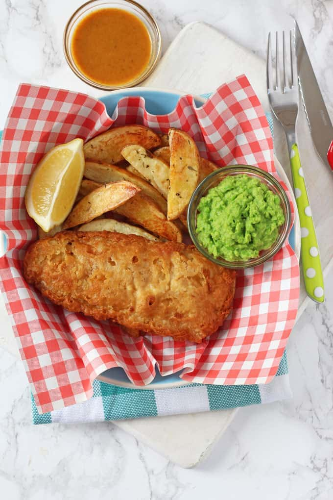 Chip Shop style fish and chips made easy with Young's Chip Shop Cod Fillets, homemade chips, minted mushy peas and curry sauce!