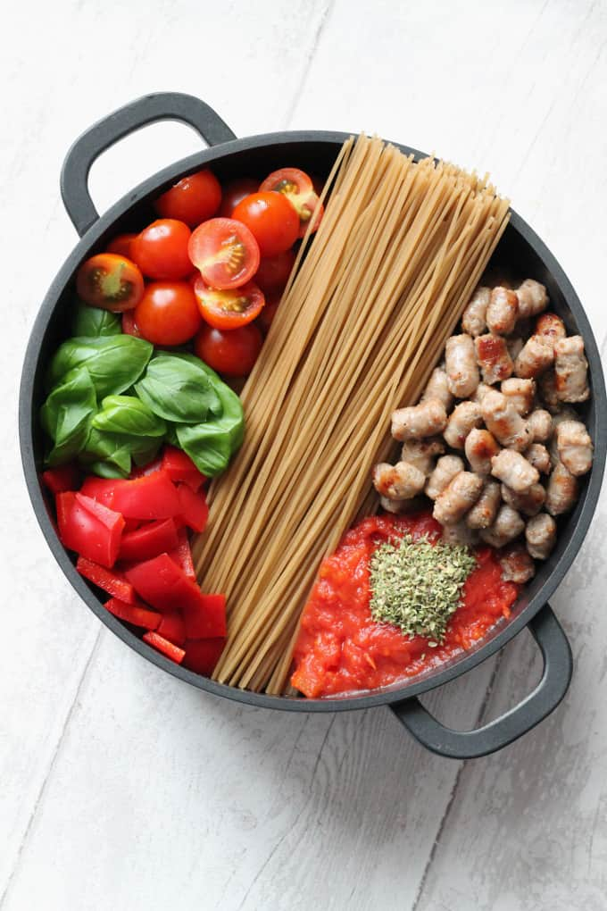 Quick, easy and convenient, this gluten free One Pot Pasta is made with organic brown rice spaghetti (but any pasta will do) and a creamy sausage and tomato sauce