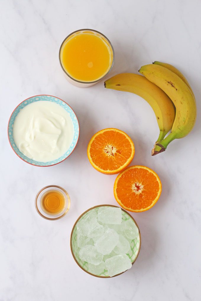 Flatlay of ingredients for a Sunshine Orange Smoothie