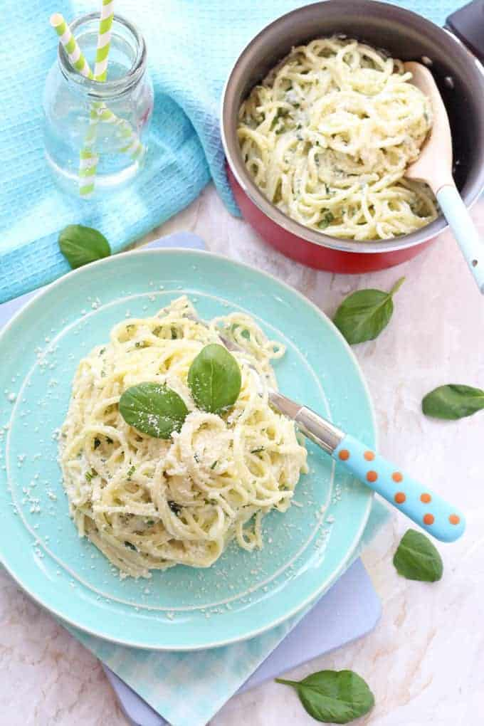 A super simple but delicious dinner recipe for kids. Creamy Basil Pesto Spaghetti. Nut free and ready in just 10 minutes!