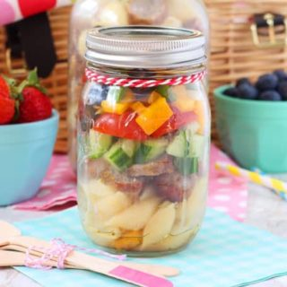 A super simple Italian Sausage Pasta Salad recipe that can be easily stored in a mason jar and taken to picnics or to work and school for lunch!