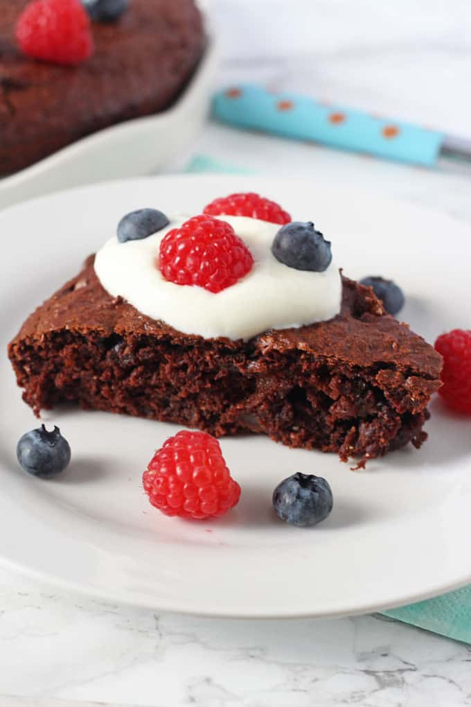 sweet potato chocolate cake served with berries and greek yoghurt