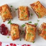 A delicious festive take on the classic sausage roll, made instead with turkey mince, cranberry sauce and brie. These mini pastry rolls will make a fantastic appetizer of party snack this Christmas!