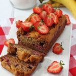 A delicious and easy Strawberry Banana Bread recipe, made a little healthier with no refined sugar. The perfect afternoon snack for hungry kids!