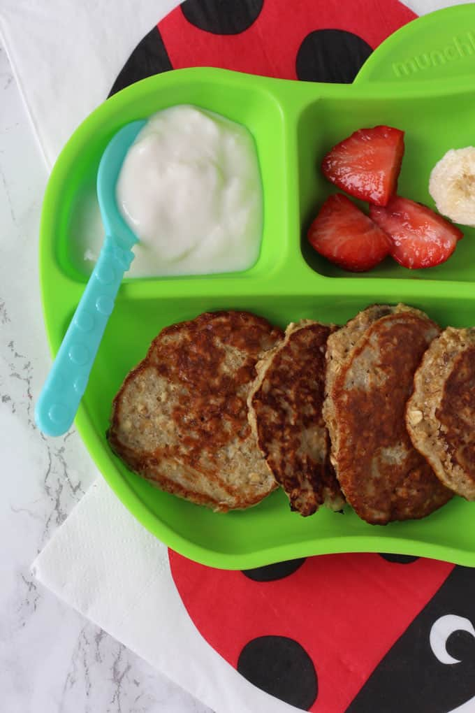 Close up of baby led weaning pancakes on a green plate