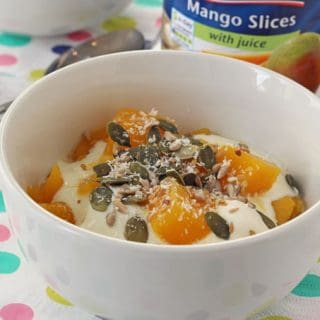 Princes Mango with Juice served with yogurt, seeds and coconut