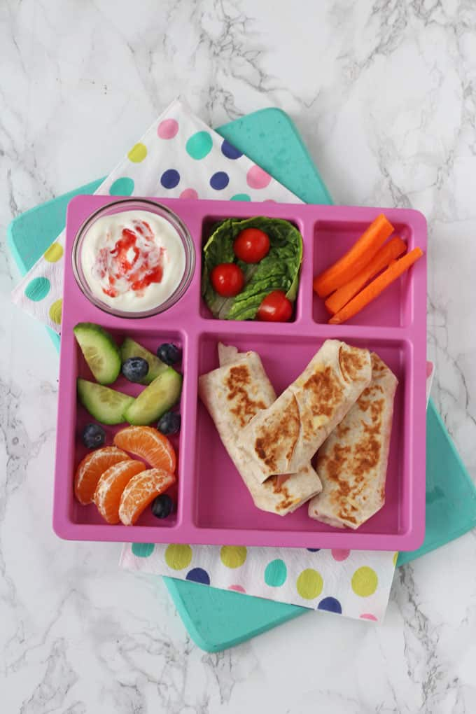 melty ham & cheese wraps served with fruit, vegetables & yoghurt