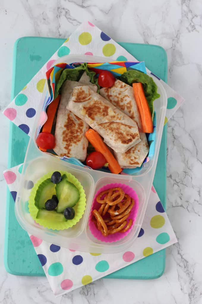 ham & cheese wraps served in a lunchbox