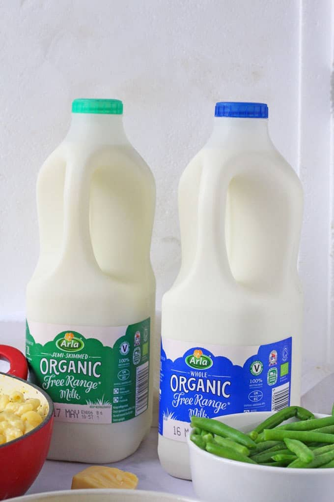 Two bottles of Arla Organic Milk