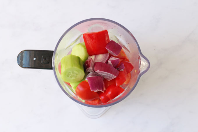 Ingredients for gazpacho soup in a blender
