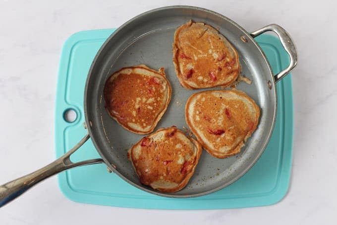 Frying pan with four pancakes