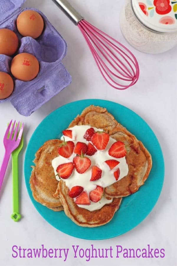 Strawberry Pancakes topped with yogurt