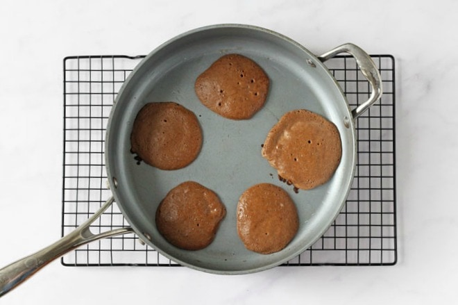 Chocolate pancakes in a frying pan