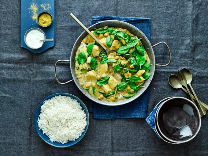 Coconut Chicken Curry in a large bowl with spinach and boiled rice