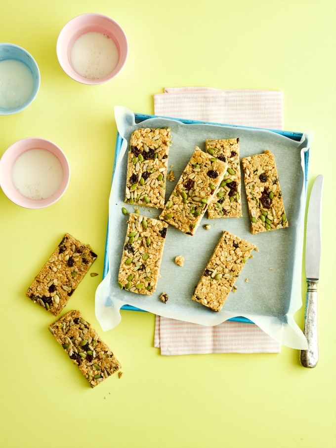 No Bake Peanut Butter Flapjacks on a blue tray and yellow background