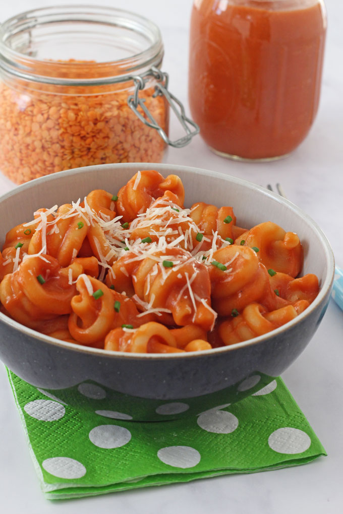 Pasta mixed with red lentil sauce