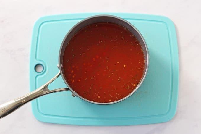 Red lentil sauce in a saucepan