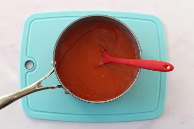 Blended red lentil sauce in a saucepan