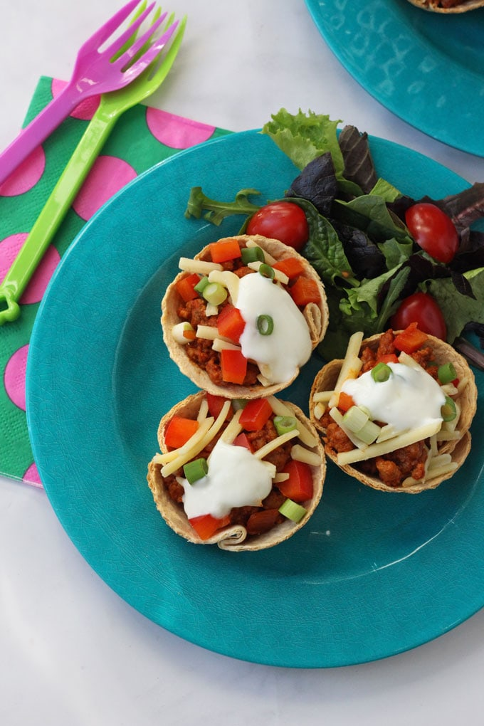 Quorn Taco Cups. Delicious baked tortilla cups filled with mexican quorn and topped with sour cream, cheese and peppers