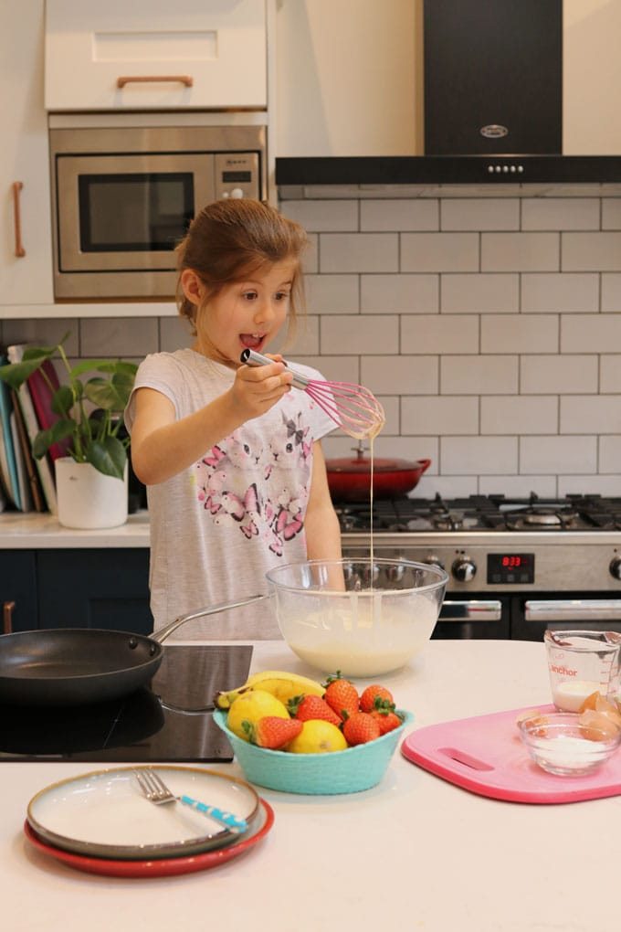 Girl making pancakes