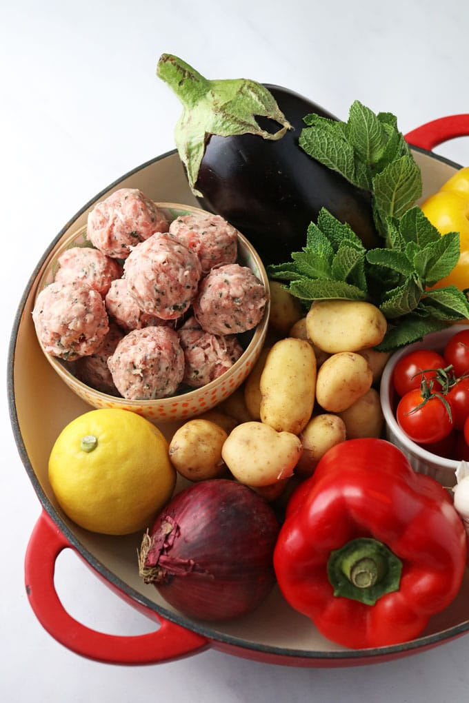 Ingredients in a dish for One Pot Greek Lamb Meatballs
