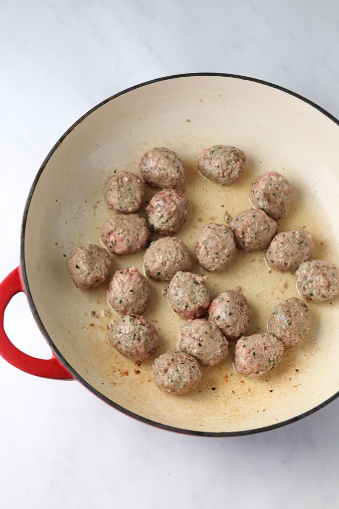Lamb Meatballs frying in a pan