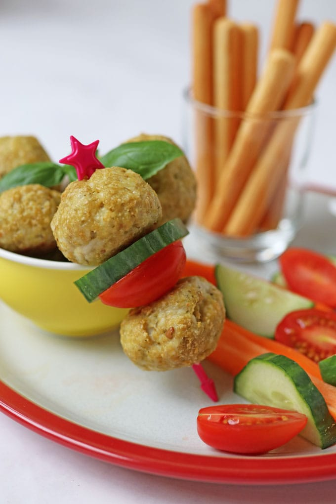 Chicken Meatballs on a skewer with tomato and cucumber