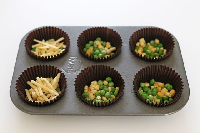 peas, sweetcorn and cheese in muffin cases