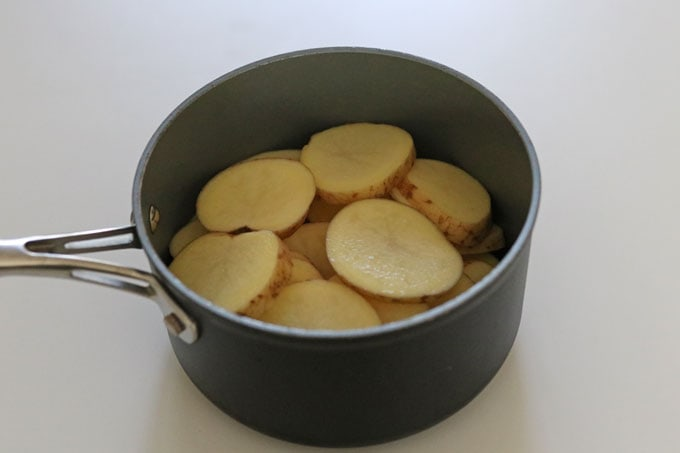 sliced potatoes in pan