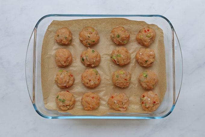 Sweet chilli chicken meatballs in baking dish