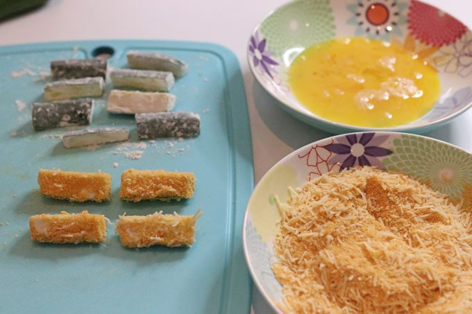 courgette sticks coated in flour, egg and parmesan mixture