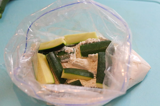 courgettes in a bag with plain flour