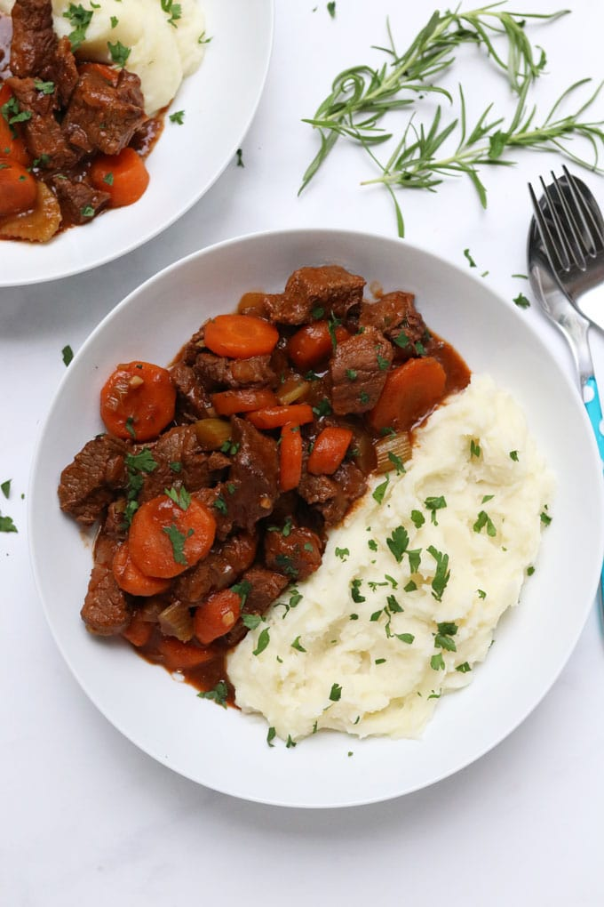 slow cooker beef casserole served with mashed potato