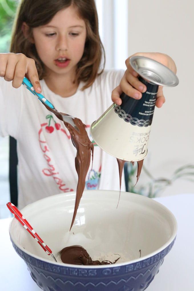 child making brownies