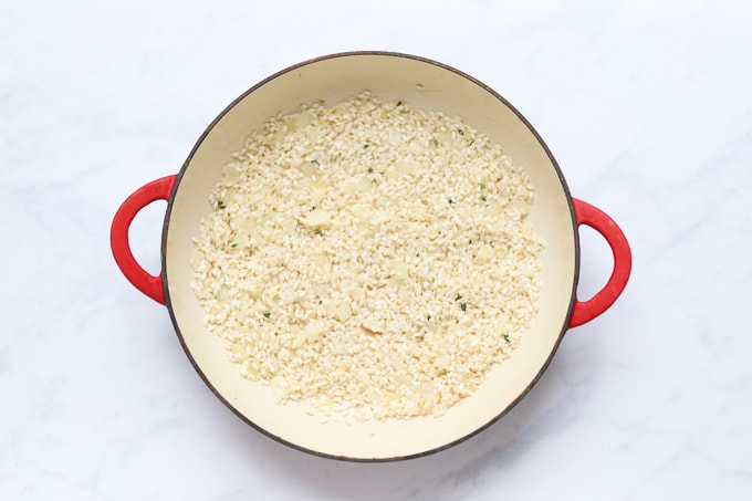 oil, chopped onion, garlic, thyme and risotto rice in an oven proof dish