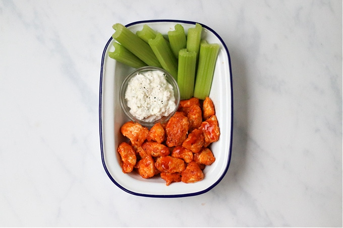 buffalo chicken served with celery and blue cheese dip