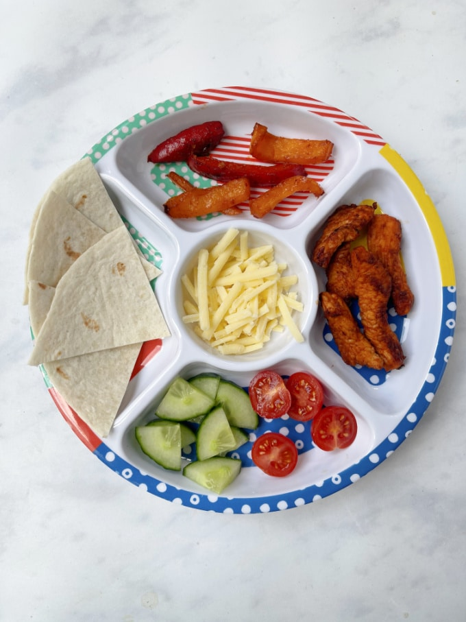deconstructed turkey wrap for kids served on a pick plate