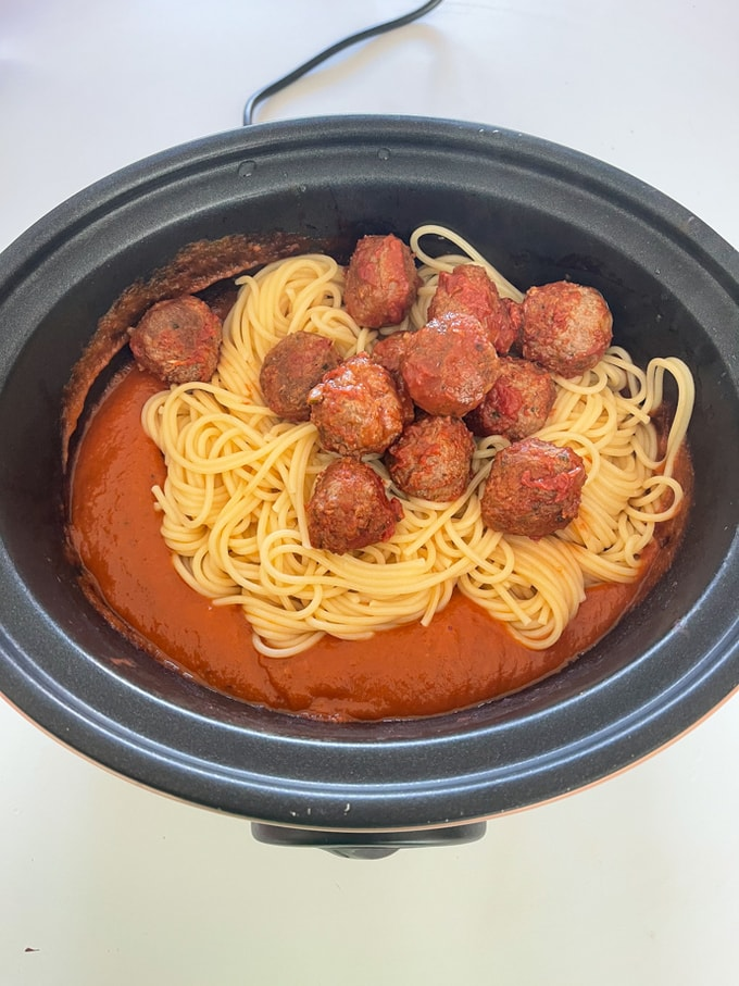 meatballs and spaghetti added to the meatball sauce in the slow cooker