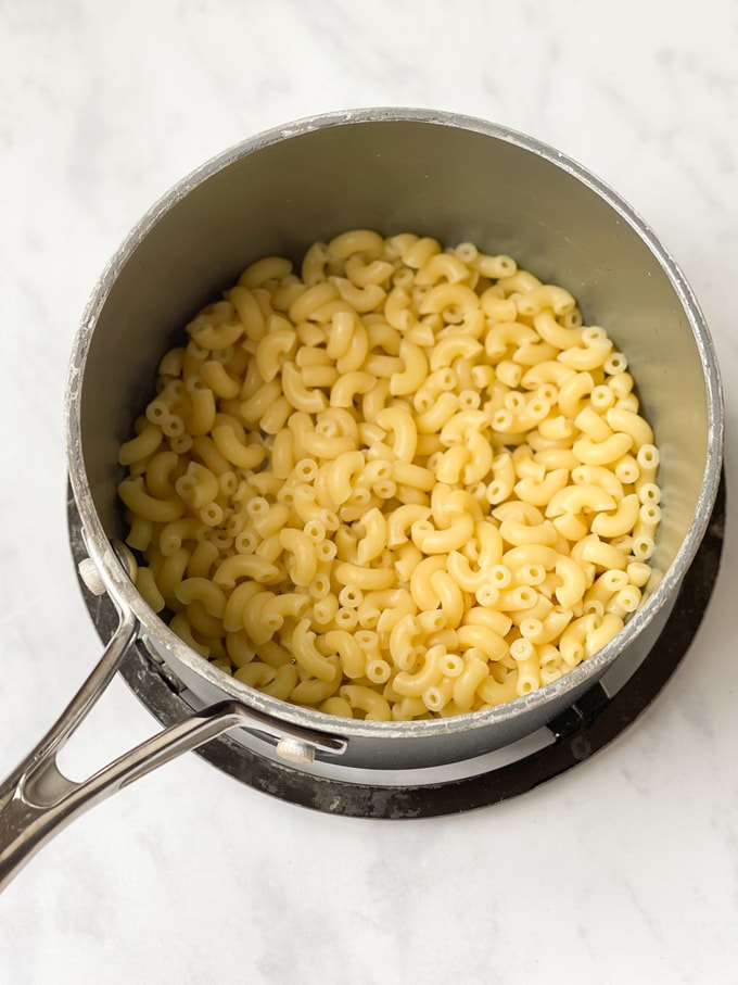 cooked macaroni in a saucepan on a trivet