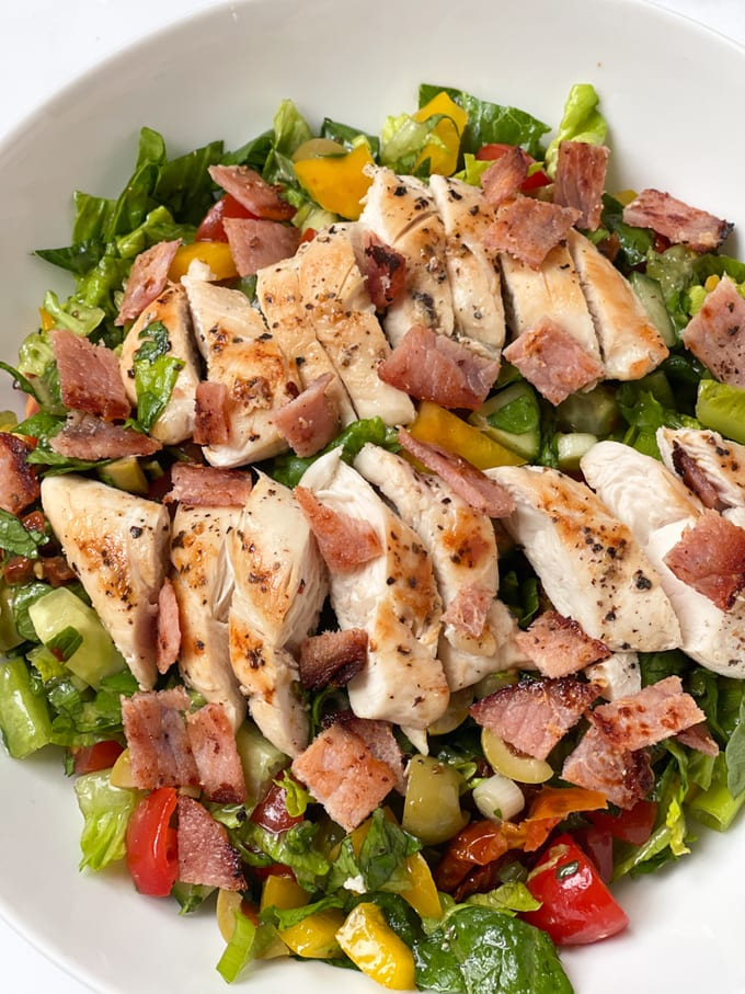 chicken & bacon salad served in a white bowl