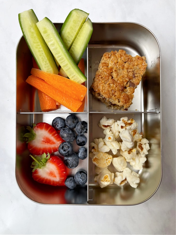 Nut Free Granola Bar in a lunch box with fruit and vegetables